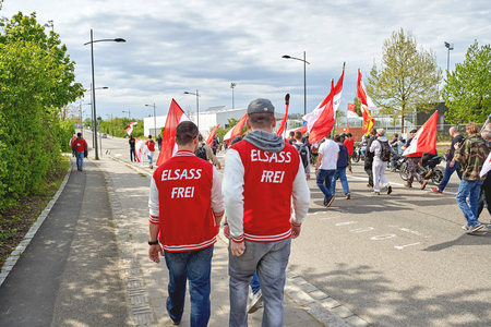 protesters: STRASBOURG, FRANCE - APR 30, 2016: Elsass Frei (Free Alsace) text on protesters clothes as crowd protest against government regional reform for the fusion of the Alsace region with Lorraine and Champagne-Ardenne