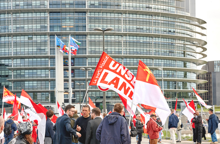 frei: STRASBOURG, FRANCE - APR 30, 2016: Closed street at European Parliament as crowd protest against government regional reform for the fusion of the Alsace region with Lorraine and Champagne-Ardenne Editorial