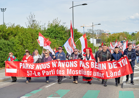 est: STRASBOURG, FRANCE - APR 30, 2016: Paris we dont need you placard as crowd protest against government regional reform for the fusion of the Alsace region with Lorraine and Champagne-Ardenne