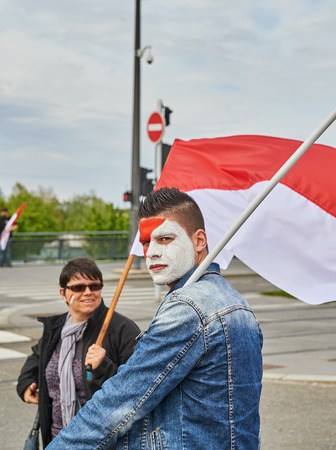 frei: STRASBOURG, FRANCE - APR 30, 2016: Man with ainted face looking at camera as crowd protest against government regional reform for the fusion of the Alsace region with Lorraine and Champagne-Ardenne Editorial