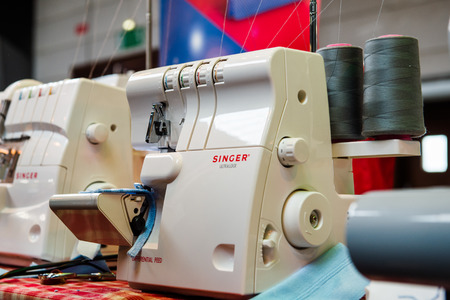 maquinas de coser: STRASBOURG, FRANCE - APR 24, 2016: Singer sewing machines at traditional textile covered market with multiple different colors and textures