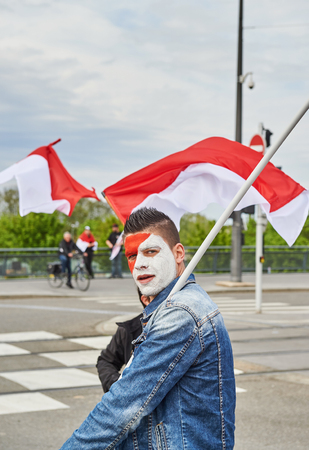 est: STRASBOURG, FRANCE - APR 30, 2016: Man with ainted face looking at camera as crowd protest against government regional reform for the fusion of the Alsace region with Lorraine and Champagne-Ardenne Editorial