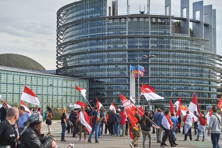 european parliament: STRASBOURG, FRANCE - APR 30, 2016: Closed street at European Parliament as crowd protest against government regional reform for the fusion of the Alsace region with Lorraine and Champagne-Ardenne Editorial