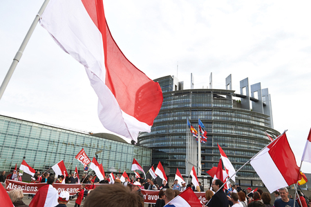 european parliament: STRASBOURG, FRANCE - APR 30, 2016: Main entrance at European Parliament with crowd protesting against government regional reform for the fusion of the Alsace region with Lorraine and Champagne-Ardenne Editorial