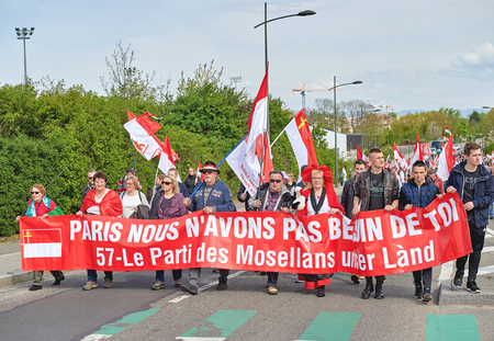 frei: STRASBOURG, FRANCE - APR 30, 2016: Paris we dont need you placard as crowd protest against government regional reform for the fusion of the Alsace region with Lorraine and Champagne-Ardenne