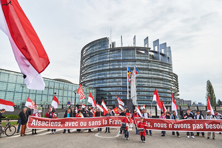 STRASBOURG, FRANCE - APR 30, 2016: Main entrance at European Parliament with crowd protesting against government regional reform for the fusion of the Alsace region with Lorraine and Champagne-Ardenne Editorial