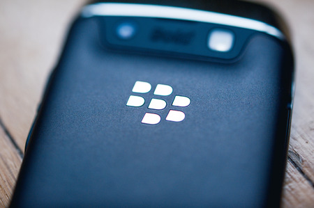 PARIS, FRANCE - APR 21, 2013: Rear view of a Blackberry phone with the chrome logotype. BlackBerry is a line of wireless handheld device with services designed and marketed by BlackBerry Limited, formerly known as Research In Motion. Tilt-shift lens to fo