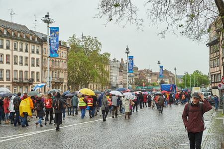 central government: STRASBOURG, FRANCE - MAY 12, 2016: Closed central street thousand of people demonstrate as part of nationwide day of protest against labor reforms by France Government