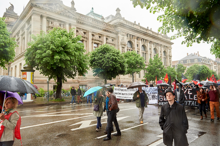 heavy rain: STRASBOURG, FRANCE - MAY 12, 2016: Closed boulevard under heavy rain as thousand of people demonstrate as part of nationwide day of protest against labor reforms by France Government