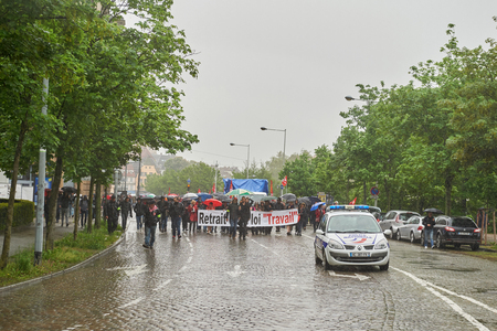 nationwide: STRASBOURG, FRANCE - MAY 12, 2016: Police surveillance of thousands of people demonstrate as part of nationwide day of protest against labor reforms by France Government