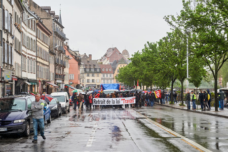 central government: STRASBOURG, FRANCE - MAY 12, 2016: Closed central street as thousand of people demonstrate as part of nationwide day of protest against labor reforms by France Government