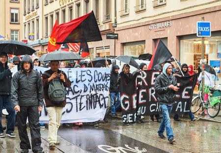 reforms: STRASBOURG, FRANCE - MAY 12, 2016: Protest messages as thousand of people demonstrate as part of nationwide day of protest against labor reforms by France Government