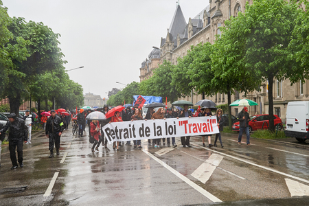 nationwide: STRASBOURG, FRANCE - MAY 12, 2016: Retire labor law placard as thousand of people demonstrate as part of nationwide day of protest against labor reforms by France Government