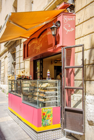 cuisine entertainment: AIX-EN-PROVENCE, FRANCE - JUL 17, 2014: Sandwich, Panninis and Pizza point on the street of the Aix-in-Provence - Typical Provence sweet pastry store in the heart of the city of Aix