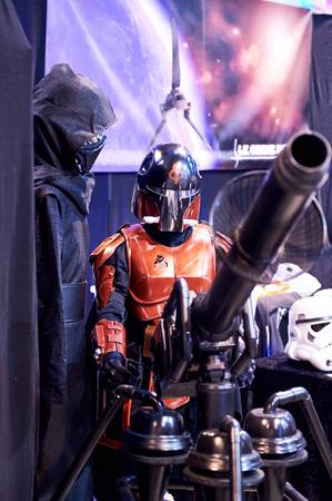 starwars: STRASBOURG, FRANCE - MAY 8, 2016: Star Wars fictional character testing a gun at the open market Digital Game Manga Show
