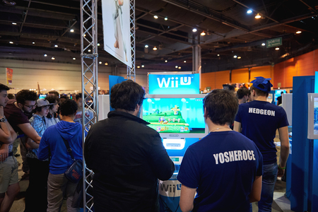 wii: STRASBOURG, FRANCE - MAY 8, 2015: Kids and adults playing WII U game consoles at the open market Digital Game Manga Show Editorial