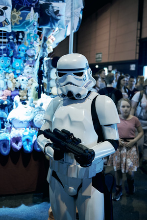 starwars: STRASBOURG, FRANCE - MAY 8, 2016: Darth Vader also known as Anakin Skywalker posing in front of camera at the open market Digital Game Manga Show