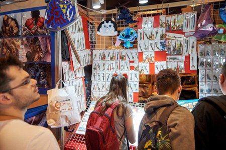 wii: STRASBOURG, FRANCE - MAY 8, 2015: Kids and adults buying souvenirs and diverse cult objects at the open market Digital Game Manga Show Editorial