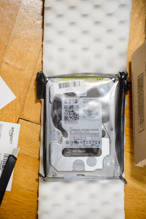 gigabyte: PARIS, FRANCE - MAR 18, 2016: Unboxing of Western Digital Hard disk drive with 6 Terabytes capacity. Western Digital is the biggest storage data manufacture worldwide