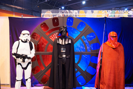 starwars: STRASBOURG, FRANCE - MAY 8, 2016: Star Wars fictional characters including Darth Wader costumes at the open market Digital Game Manga Show Editorial