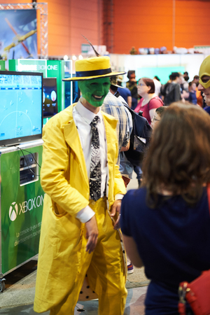 electric avenue: STRASBOURG, FRANCE - MAY 8, 2015: Man in The Mask movie yellow costume characther and Thunder man costume posing for visitors at the closed market Digital Game Manga Show Editorial