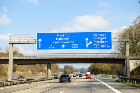 fast lane: GERMANY - MAR 26, 2016: Bundesautobahn or Federal Motorway highway street signs to Frankfurt, Mannheim, Karsruhe, Munchen, Stuttgart, Pforzheim Editorial