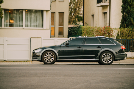 supercharged: STRASBOURG, FRANCE - MARCH 18, 2016: AUDI wagon car parked in front of luxury house Editorial