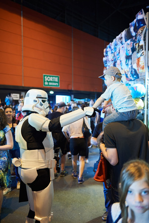game show: STRASBOURG, FRANCE - MAY 8, 2016: Darth Vader shaking hand with little fan boy at the open market Digital Game Manga Show