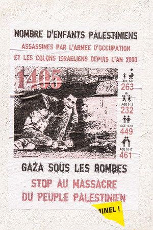 gaza: MARSEILLE, FRANCE - JUL 18, 2014: Gaza under bombs - placard about situation in Palestina seen on a wall in French city of Marseille