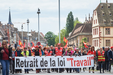 proposed: STRASBOURG, FRANCE - MAY 19, 2016: Retire labor reform placard during a demonstrations against proposed French governments labor and employment law reform