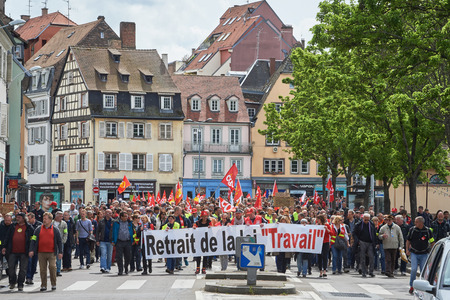 reform: STRASBOURG, FRANCE - MAY 19, 2016: Retire labor reform placard during a demonstrations against proposed French governments labor and employment law reform