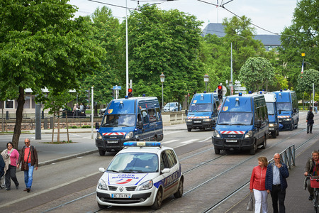 proposed: STRASBOURG, FRANCE - MAY 19, 2016: Elevated view of row of police vans surveilling protest against proposed French governments labor and employment law reform Editorial