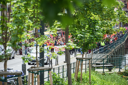 protestors: STRASBOURG, FRANCE - MAY 19, 2016: Protestors seen through green leaves during a demonstrations against proposed French governments labor and employment law reform Editorial