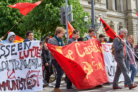 proposed: STRASBOURG, FRANCE - MAY 19, 2016: Young say no to labor low placard during a demonstrations against proposed French governments labor and employment law reform