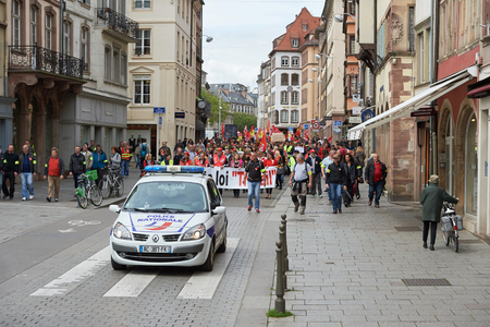 demonstrations: STRASBOURG, FRANCE - MAY 19, 2016: Retire labor reform placard during a demonstrations against proposed French governments labor and employment law reform