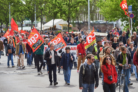 labor union: STRASBOURG, FRANCE - MAY 19, 2016: People walking with placards during a demonstrations against proposed French governments labor and employment law reform