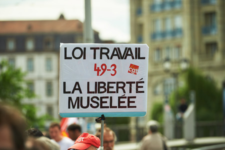 proposed: STRASBOURG, FRANCE - MAY 19, 2016: Anti-labor placard during a demonstrations against proposed French governments labor and employment law reform Editorial