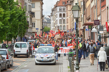 conflictos sociales: STRASBOURG, FRANCE - MAY 19, 2016: People marching on closed central streets in Strasbourg woth retire labor reform placard during a demonstration against proposed French governments labor and employment law reform