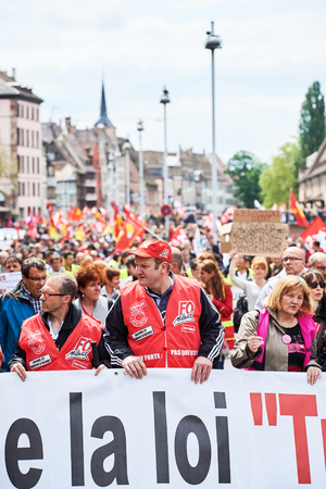 social conflicts: STRASBOURG, FRANCE - MAY 19, 2016: Retire labor reform placard during a demonstrations against proposed French governments labor and employment law reform