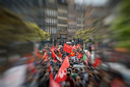 labor union: STRASBOURG, FRANCE - MAY 19, 2016: Zoom out from Communist Flag Place Broglie during a demonstrations against proposed French governments labor and employment law reform Editorial