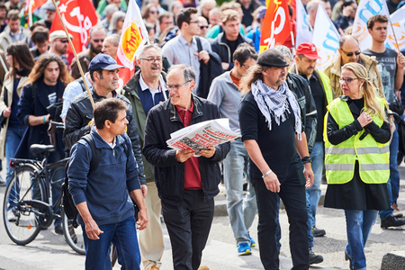 proposed: STRASBOURG, FRANCE - MAY 19, 2016: People walking with placards during a demonstrations against proposed French governments labor and employment law reform
