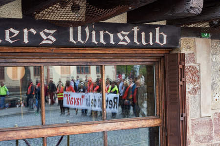 conflictos sociales: STRASBOURG, FRANCE - MAY 19, 2016: Reflection of protesters in Winstub Restaurant during a demonstrations against proposed French governments labor and employment law reform