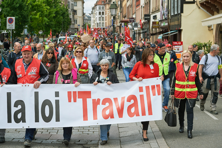 labor union: STRASBOURG, FRANCE - MAY 19, 2016: People marching on closed central streets in Strasbourg woth retire labor reform placard during a demonstration against proposed French governments labor and employment law reform