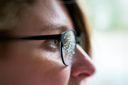 caucasian water drops: Side view of woman wearing eyeglasses with rain drops after the rain