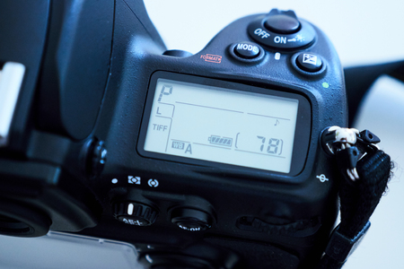 dslr: Detail of DSLR Digital Single Reflex camera in study environment