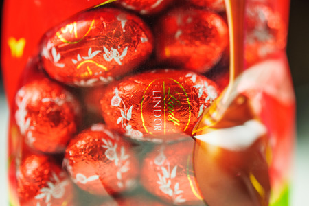 lindt: KILCHBERG, SWITZERLAND - MARCH 20, 2014: Lindt Lindor chocolate truffle easter egg chocolate. Lindt is one one of the lastgest luxury chocolate and confectionery company worldwide with more than 30 factories worldwide Editorial