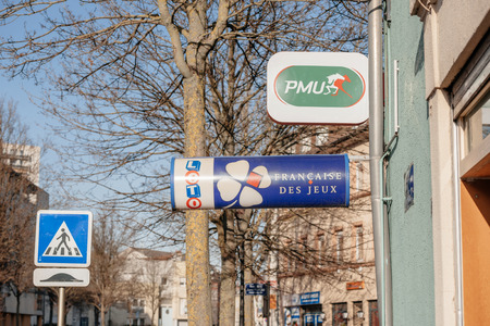 loto: MULHOUSE, FRANCE - PMU and LOTO de France lottery signs next to bookmaking office on the central city street in France