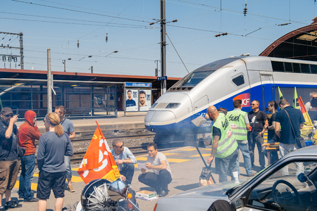 STRASBOURG, FRANCE - JUN 6, 2016: Protesters making barbeque outside the Gare de Strasbourg, during a demonstration by railway workers of French state rail operator SNCF, as part of a strike to defend their work conditions. Editorial