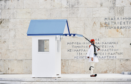 tomb of the unknown soldier: Athens, Greece - March 27, 2016: The changing of the honor Evzones guards ceremony in front of  the Tomb of the Unknown Soldier at the Parliament Building in Syntagma Square, Athens, Greece.