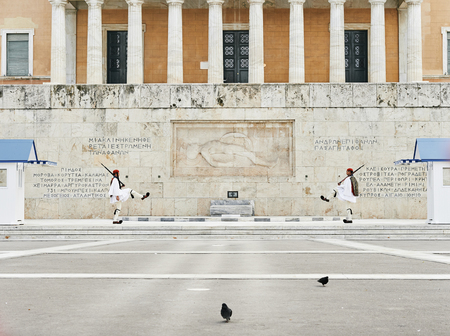 syntagma: Athens, Greece - March 27, 2016: Perfect the coordination of movements during the changing of the honor Evzones guards ceremony in front of  the Tomb of the Unknown Soldier at the Parliament Building in Syntagma Square, Athens, Greece.